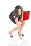 Buigen het bedrijfs van de Vrouw met rode omslag Stock Foto