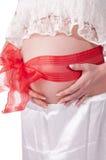 Buik van een zwanger meisje Stock Afbeelding