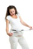 Buik van zwangere vrouwenmeting van band Royalty-vrije Stock Foto's