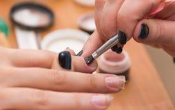build artificial nails, manicures, artificial nails correction, Royalty Free Stock Photos