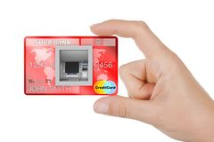 Build In Bank Cash ATM Machine in Credit Card in Woman Hand. 3d. Build In Bank Cash ATM Machine in Credit Card in Woman Hand extreme closeup. 3d Rendering Stock Photo