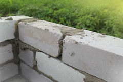 Build a brick wall Stock Photos