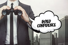 Build confidence text on blackboard with businessman. And key royalty free stock images