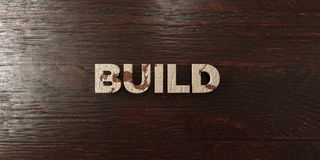 Build - grungy wooden headline on Maple  - 3D rendered royalty free stock image Royalty Free Stock Photography