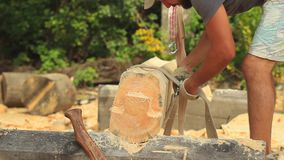 Build a house from logs. A log is hoisted with a crane to build a house stock footage