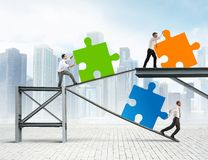 Build a new company. Concept of Build a new company with puzzle stock image