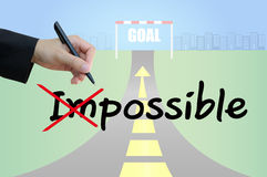 Build opportunity by change impossible to possible business concept. Business hand cross impossible to possible and highway road going up as an arrow background Royalty Free Stock Photos