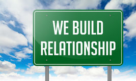 We Build Relationship on Highway Signpost. Royalty Free Stock Photo
