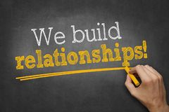 We build relationships - hand writing business concept on chalkboard