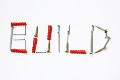 Build text typography. The word build composed of screws, nails and anchors stock photography