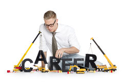 Career start up: Businessman building career-word. Stock Images