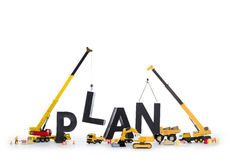 Build up a plan: Machines building plan-word. Royalty Free Stock Images