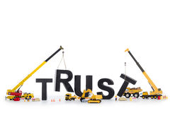 Build up trust: Machines building trust-word. stock photos
