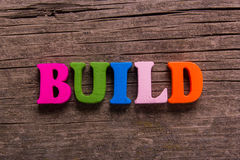 Build word made of wooden letters Stock Photography