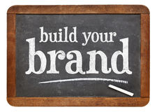 Build your brand blackboard sign. Build your brand - white chalk text on a vintage slate blackboard stock images