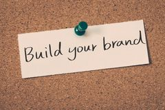 Build your brand. Concept message on a cork board stock photography