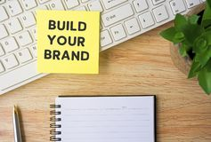 Build Your Brand. Typed on yellow paper on top of computer keyboard royalty free stock photo