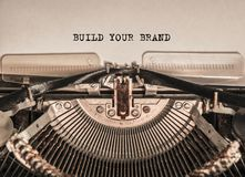 BUILD YOUR BRAND printed the words. On a typewriter. letters on paper stock image