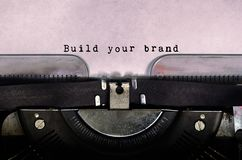Build your brand. Typed on a vintage typewriter royalty free stock photography
