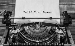BUILD YOUR BRAND typed words. On a old vintage typewriter. Close up royalty free stock photography