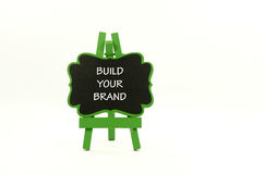Build your brand. Word build your brand on wooden easel royalty free stock photos