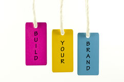 Build your brand. Word build your brand on wooden tag royalty free stock images