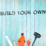 Build your own against tools on wooden background Stock Photos