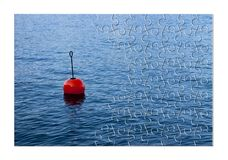 Build your security step by step - Concept image, with red bouy. On a calm lake, in jigsaw puzzle shape stock photo