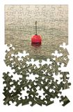 Build your security step by step - Concept image with red bouy on a calm lake, in jigsaw puzzle shape.  stock images