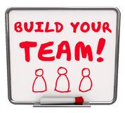 Build Your Team Workers Employees Common Goal Mission Words Boar. Build Your Team words on a dry erase board telling you to put together a group of employees Royalty Free Stock Photos