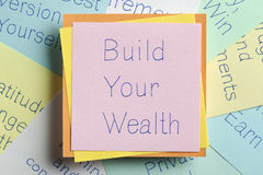 Build Your Wealth written on a note Stock Photo