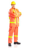 Builder. Young handsome builder in yellow uniform. Isolated over white background Stock Photography