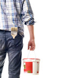 Builder. The painting brush looks out of a hip-pocket of jeans Stock Image