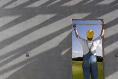 Builder. Measuring width of door Royalty Free Stock Photography