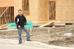 Builder. In front of new home under construction Royalty Free Stock Photo