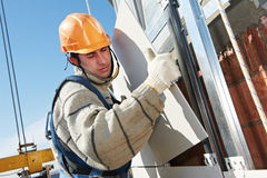 Builder at aerated facade tile installation Stock Photography