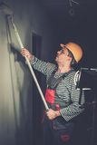 Builder applying paint Royalty Free Stock Photo