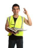 Builder apprentice student. A student apprentice construction worker builder tradesman holding an open book and showing okay sign royalty free stock images