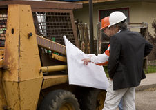 Builder and Architect. Reviewing blueprints at a construction site Stock Photo