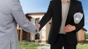 Builder or architect congratulating a client Royalty Free Stock Photo