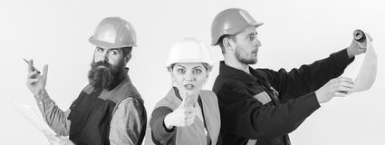 Builder, architect, repairman searching handyman. Men and woman in helmets busy with different tasks Stock Images