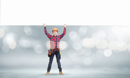 Builder with banner Stock Photos