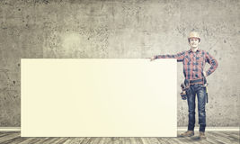 Builder with banner Royalty Free Stock Photo