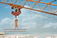 Builder with bare torso standing on iron construction. Stock Photos