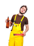 Builder with beer Royalty Free Stock Image