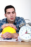 Builder being woken up Stock Photography