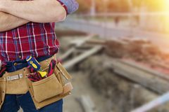 Builder with the belt of tools Stock Photo