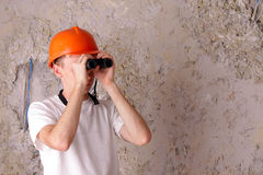 Builder with binoculars at the background Stock Images