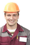 Builder with blank name tag Stock Photo