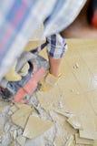 Builder breaking up floor tiles with machine Stock Photos